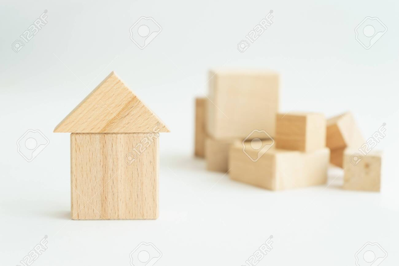 miniature small house made wooden blocks background of a stack of cubes for assembly. - 130440469