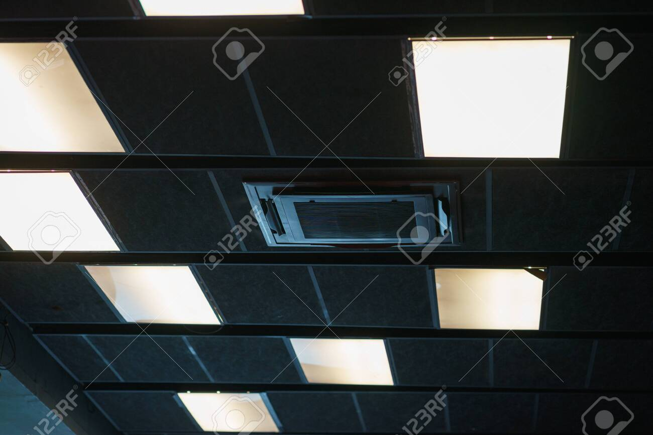 Black design and details of the modern device ceilings in the room. Devices for ventilation air conditioning, ceiling speakers and lighting devices. Details of the modern interior. - 131601465