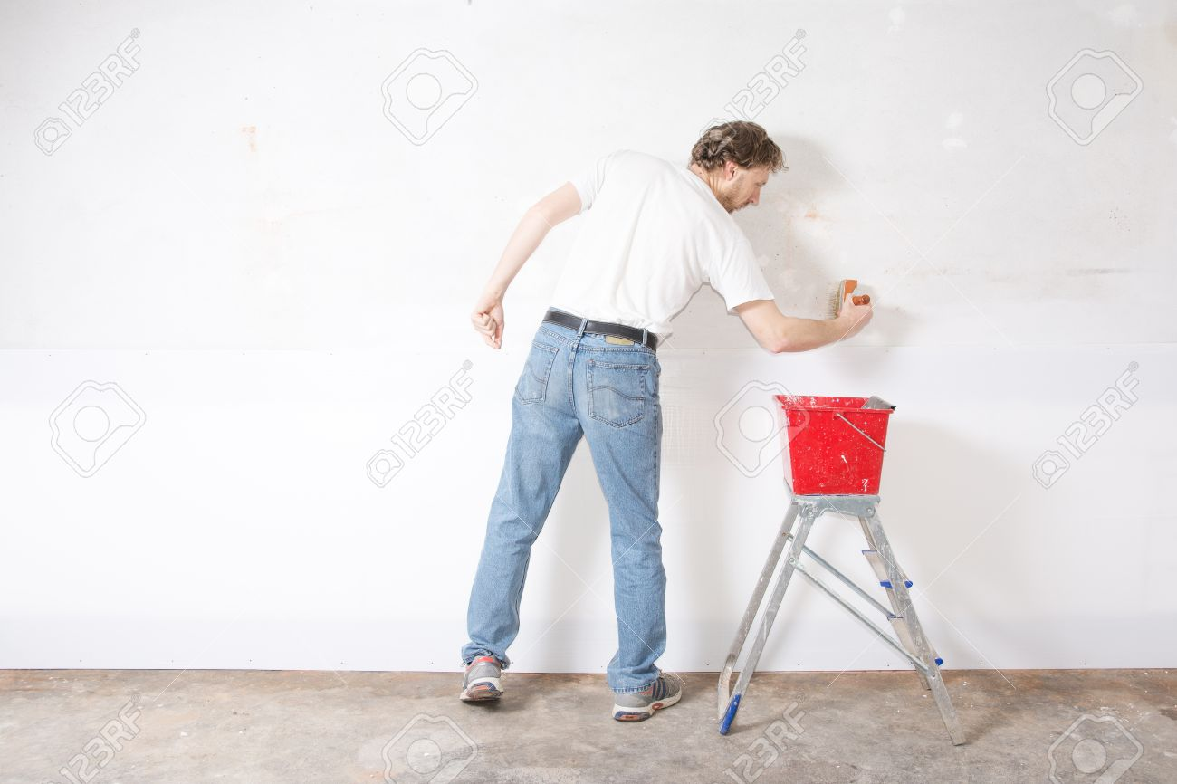 Person painting wall - Man Painting A Wall White With Paint Brush Stock Photo 27880539
