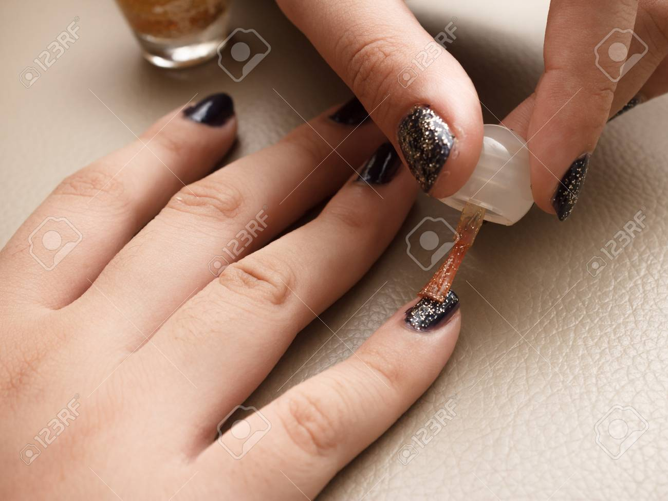 Someone Gently Applying Glitter Color Nail Polish Using A Brush ...