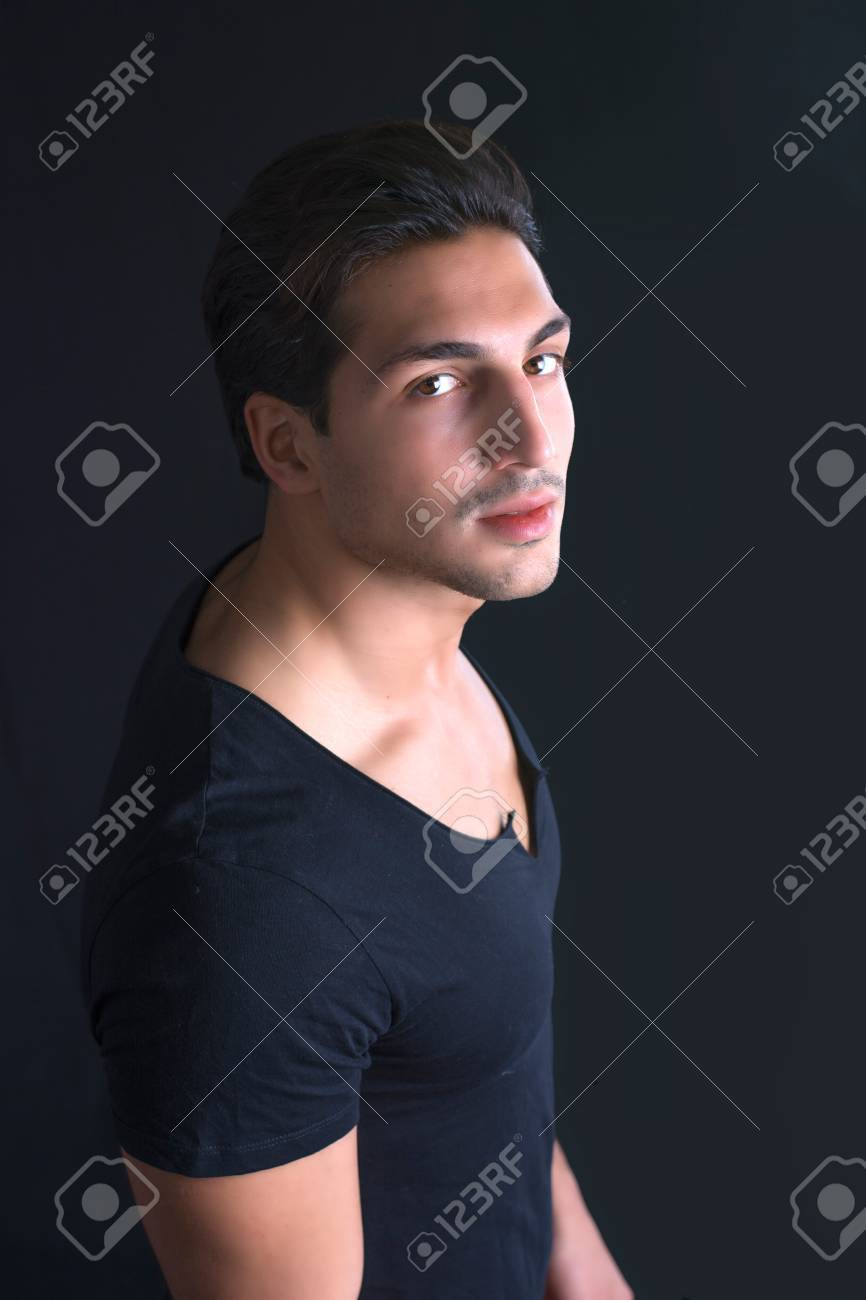 Brown Eyed Black Haired Latin Man On Dark Background Photographed