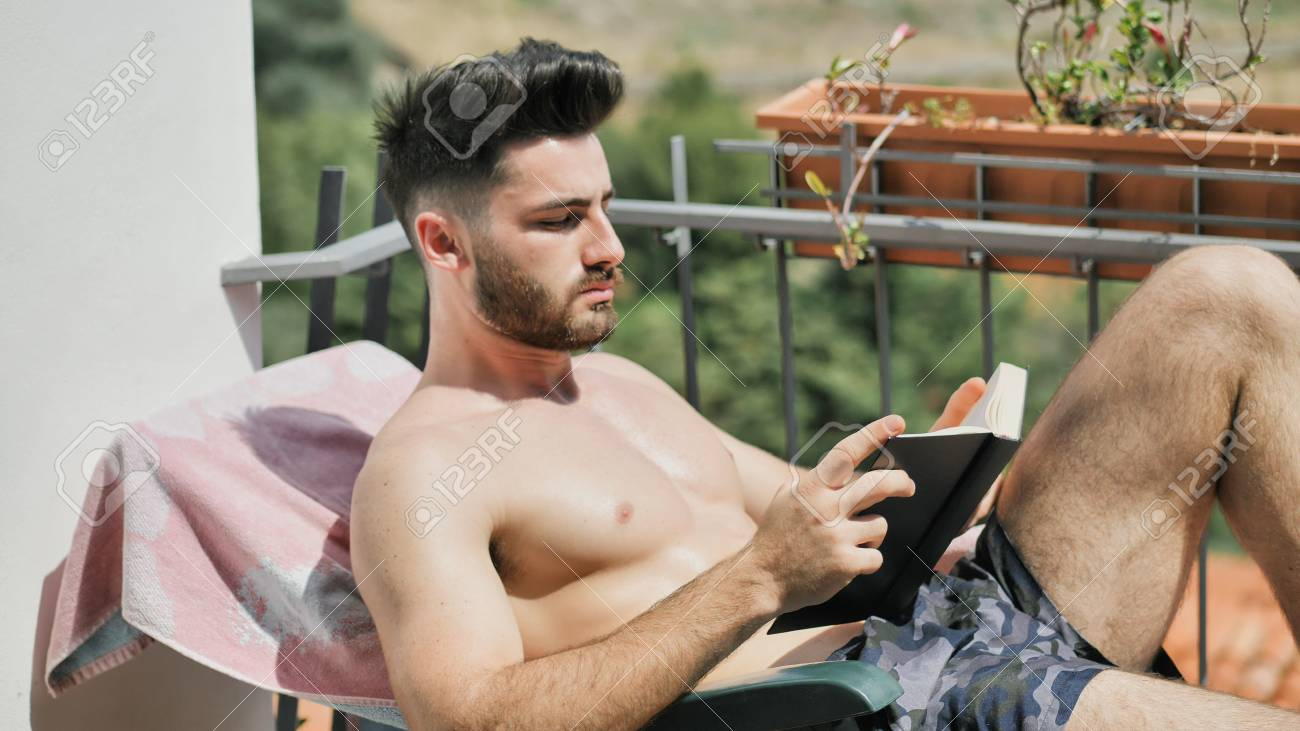 d6885df0aa Shirtless Young Man Drying Off in Hot Sun Reading a Book, Muscular Man  Wearing Bathing