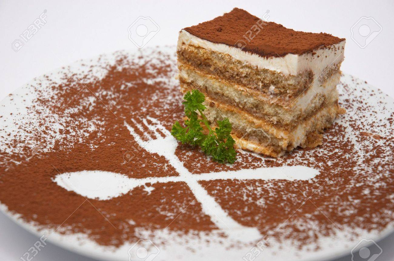 Tiramisu Dessert Served On Plate With Cpecial Decoration. Isolated
