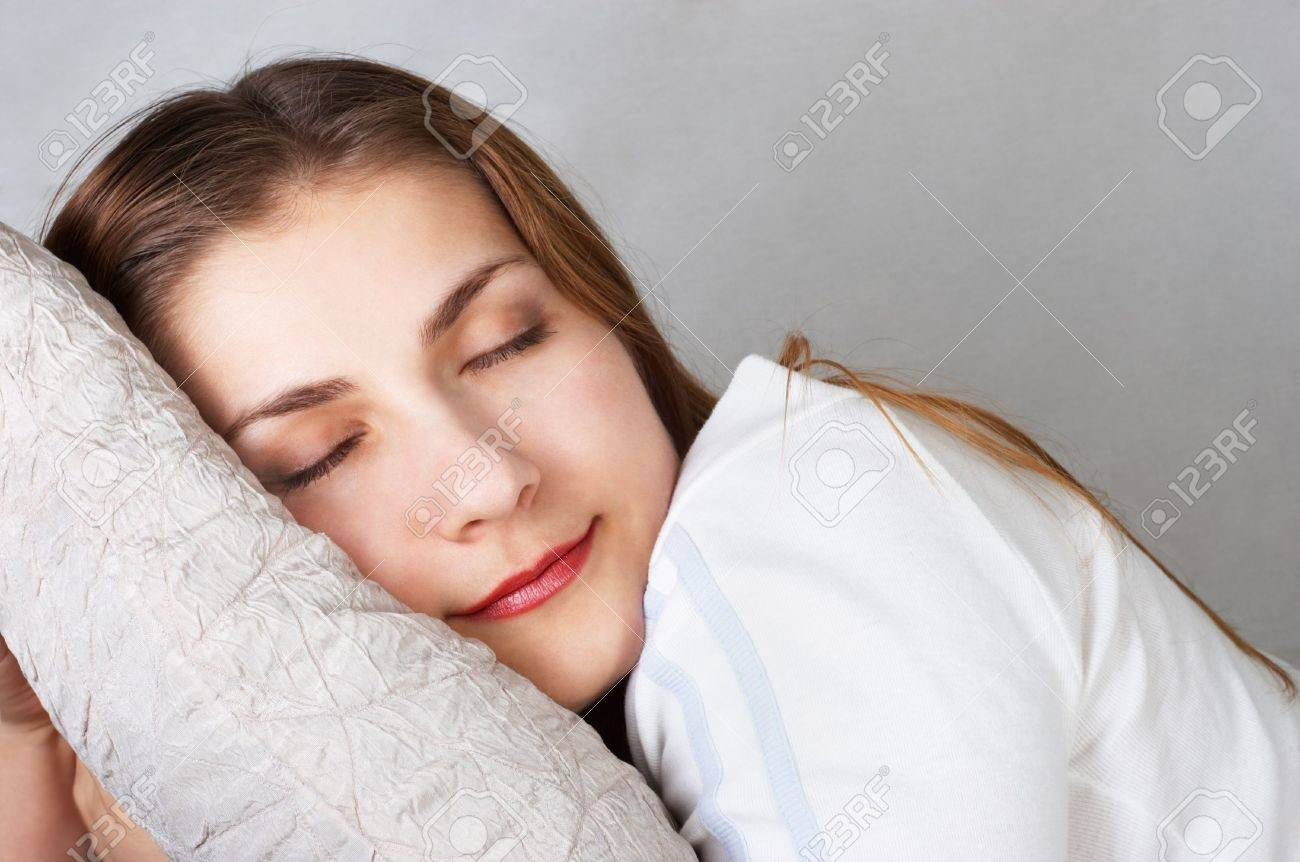 dreaming beautiful young woman lying on pillow Stock Photo - 733949