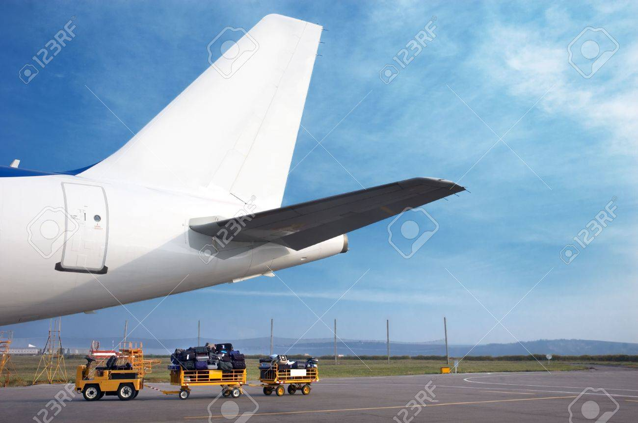 airplain tale and luggage cart on the airfield, preparing to depart Stock Photo - 2151265