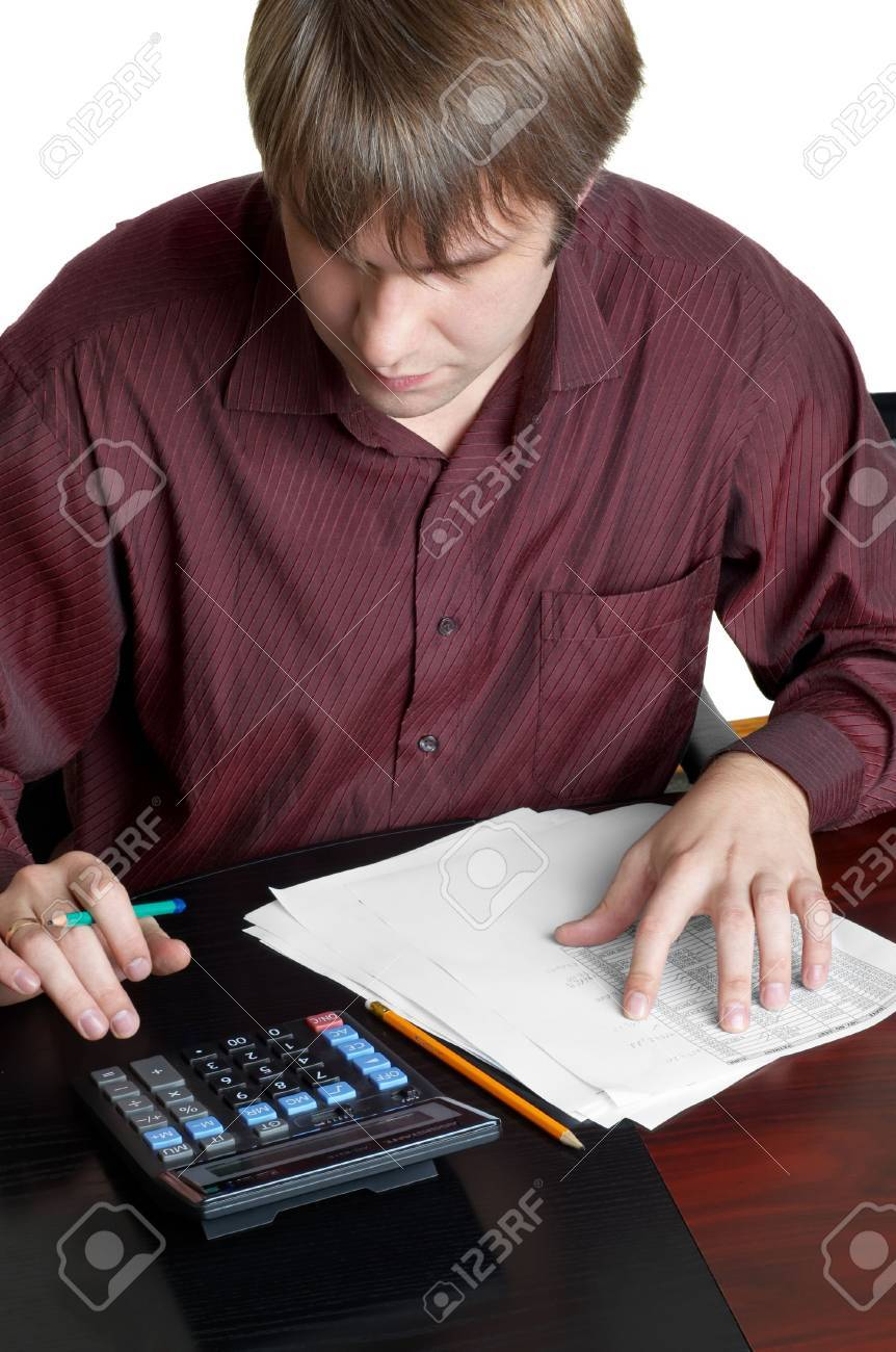 male accountant working papers and calculator stock photo stock photo male accountant working papers and calculator