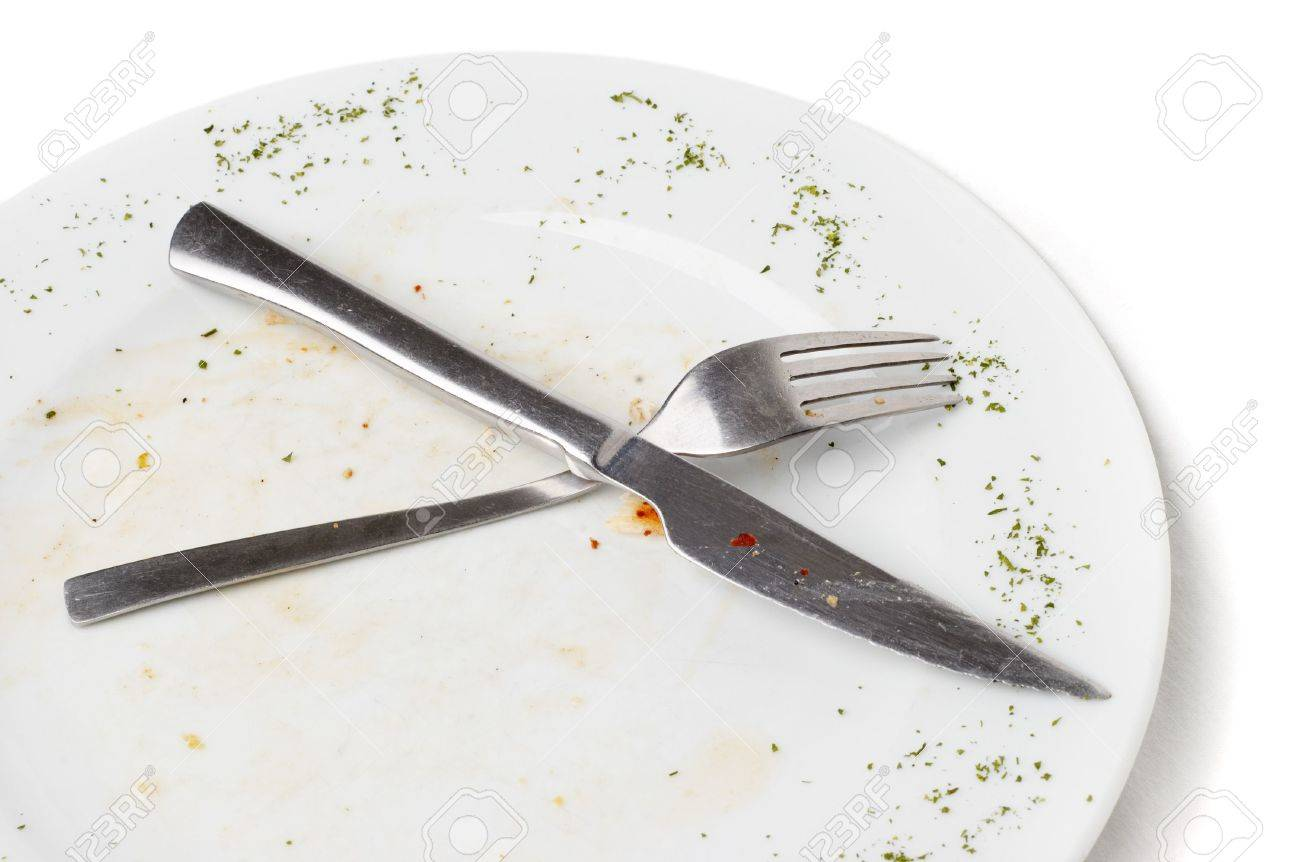 unwashed fork and knife after eating lying on plate Stock Photo - 2406728