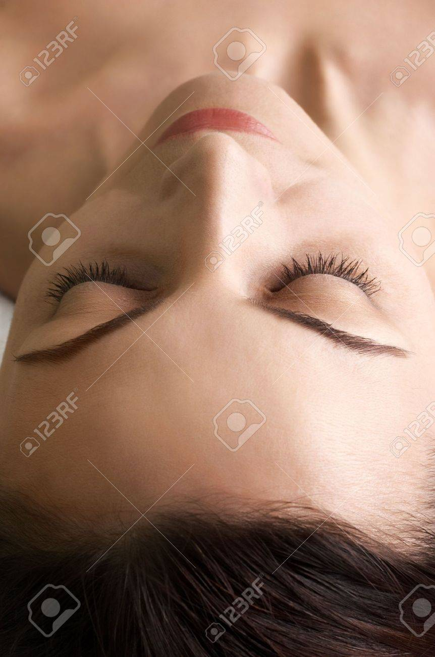 feeling of satisfaction on beautiful face. selective focus at the eyes closed and nose. Stock Photo - 2633947