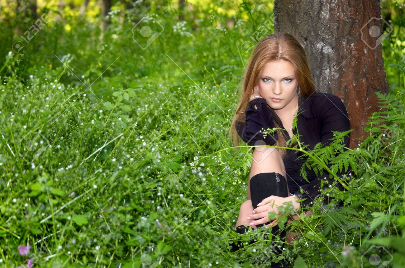 Sexy Girl In Black Boots In The Green Spring Forest Stock Photo 2933566