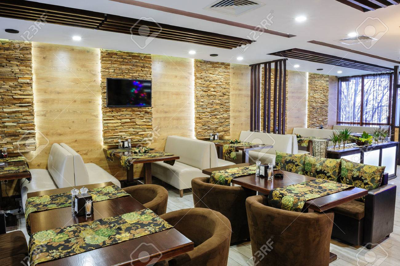 modern restaurant interior with tables and sofas stock photo