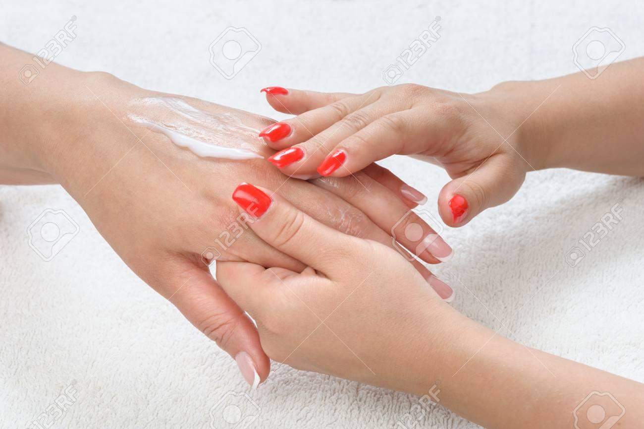 beauty salon, applying moisturizing cream onto the hands and massaging Stock Photo - 29267426