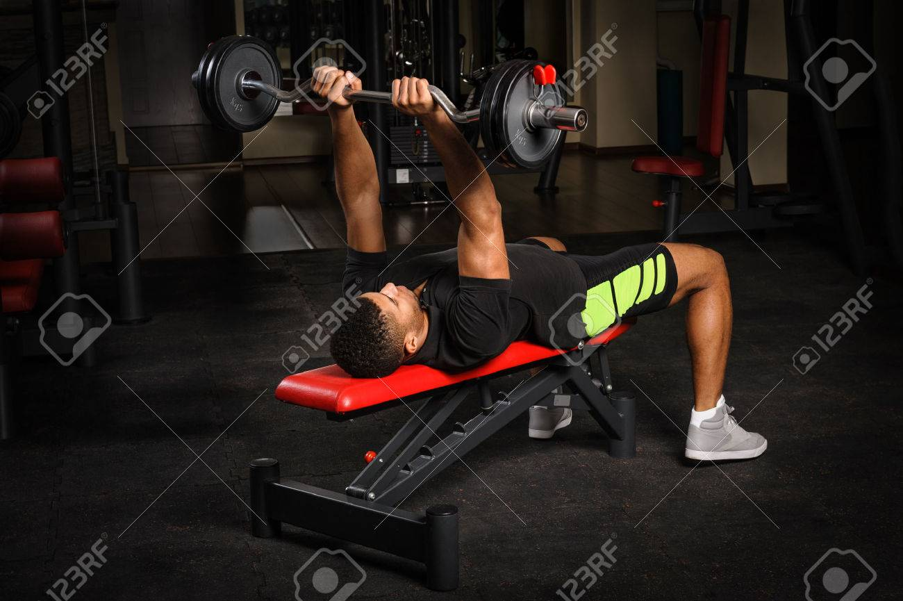 Incredible Young Man Doing Arms Bench French Press Workout In Gym Pdpeps Interior Chair Design Pdpepsorg