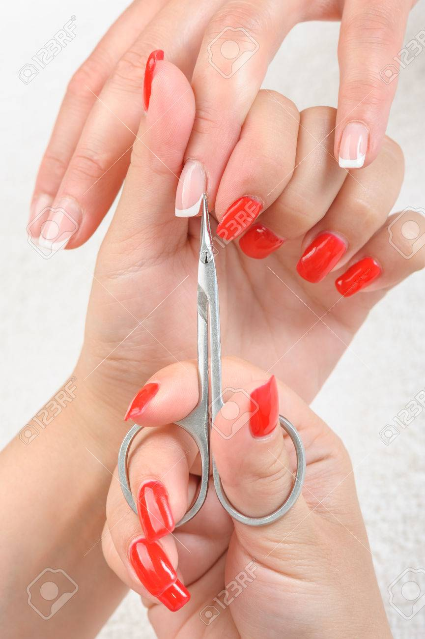 Nail Salon, Hands Beauty Treatment, Cuticles Cutting With Scissors ...