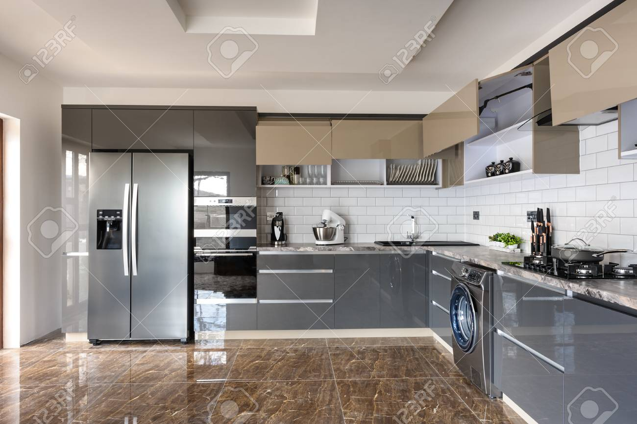 Spacious Luxury Well Designed Modern Grey Beige And White Kitchen Stock Photo Picture And Royalty Free Image Image 125236644
