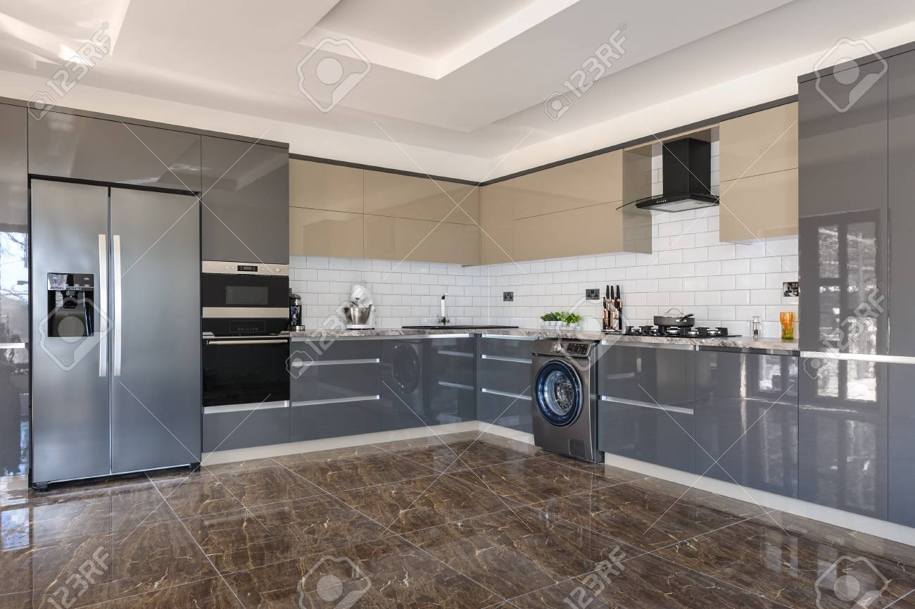 Spacious Luxury Well Designed Modern Grey Beige And White Kitchen Stock Photo Picture And Royalty Free Image Image 125236661