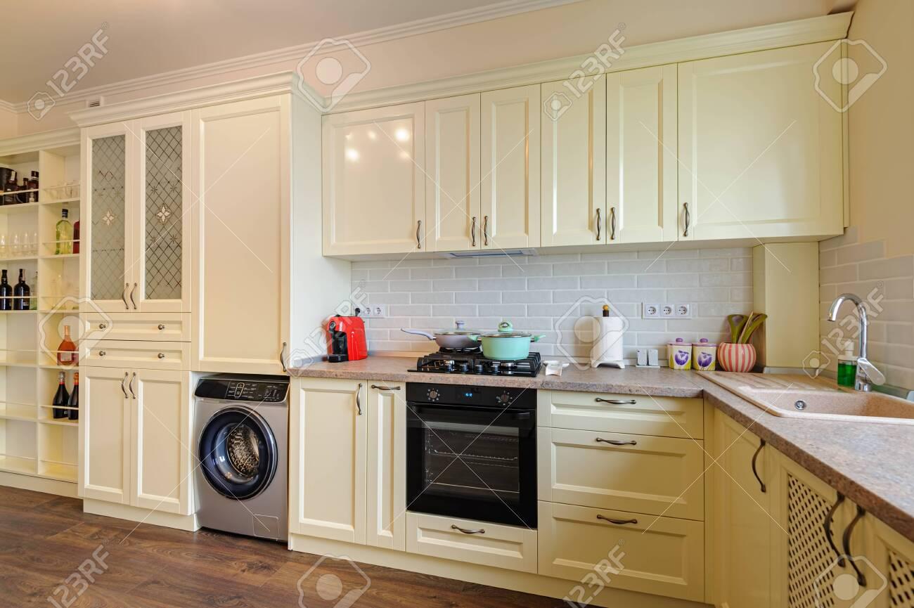 modern cream colored kitchen interior - 143068858