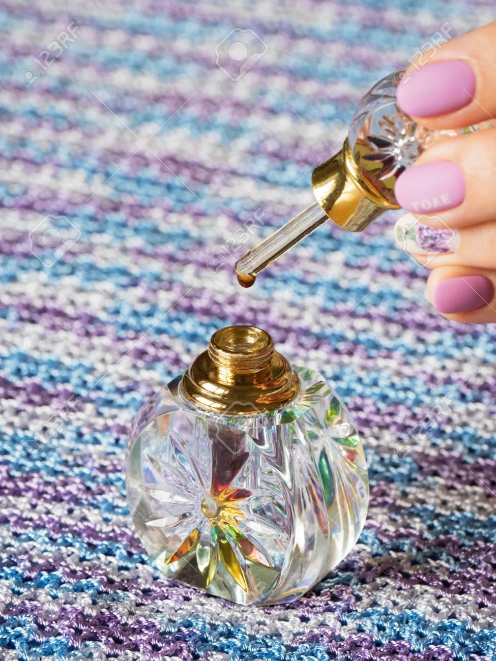 Arabian oud attar essential or agarwood oil fragrances in glass
