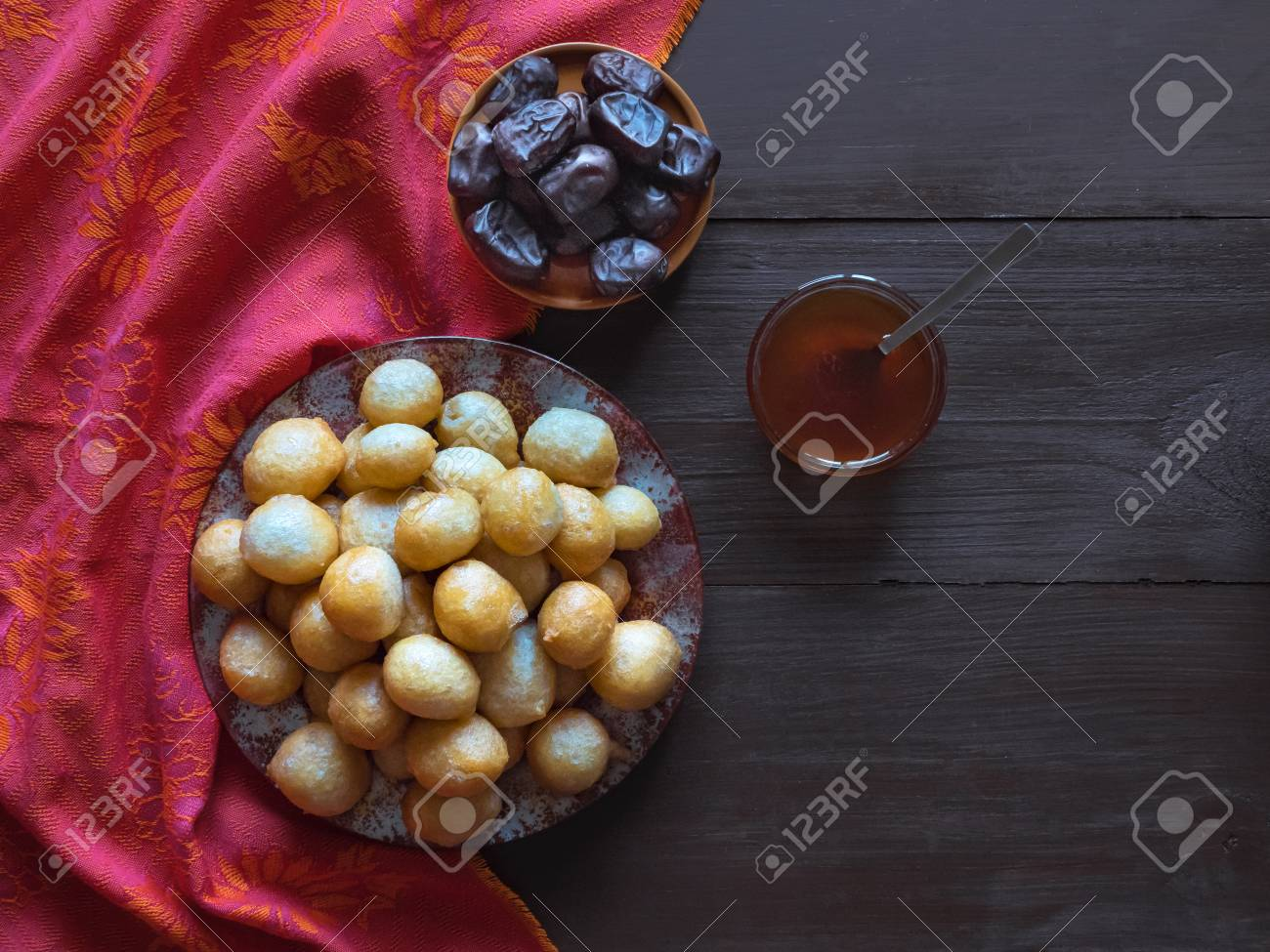 Arabic traditional Ramadan dessert Zalabya. Middle Eastern dessert Loukoumades. - 122652342