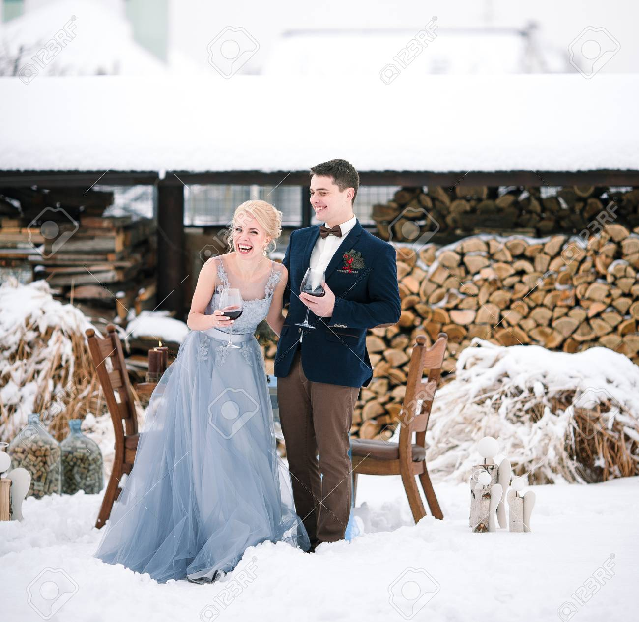 Winter Wedding Outdoor On Snow And Firewood Background Bride