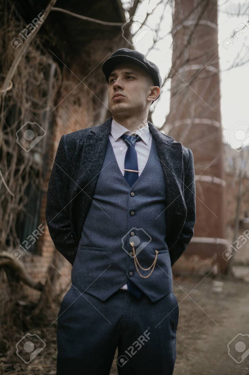 A Man Posing In The Image Of An English Retro Gangster Of The Stock Photo Picture And Royalty Free Image Image 142344435