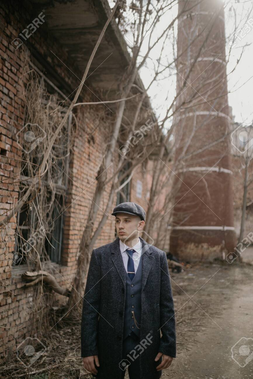 A Man Posing In The Image Of An English Retro Gangster Of The Stock Photo Picture And Royalty Free Image Image 142344436