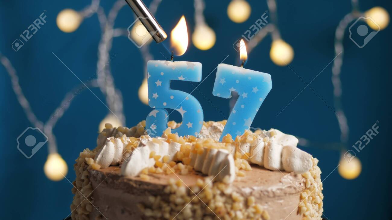 Awe Inspiring Birthday Cake With 57 Number Candle On Blue Backgraund Set On Personalised Birthday Cards Veneteletsinfo