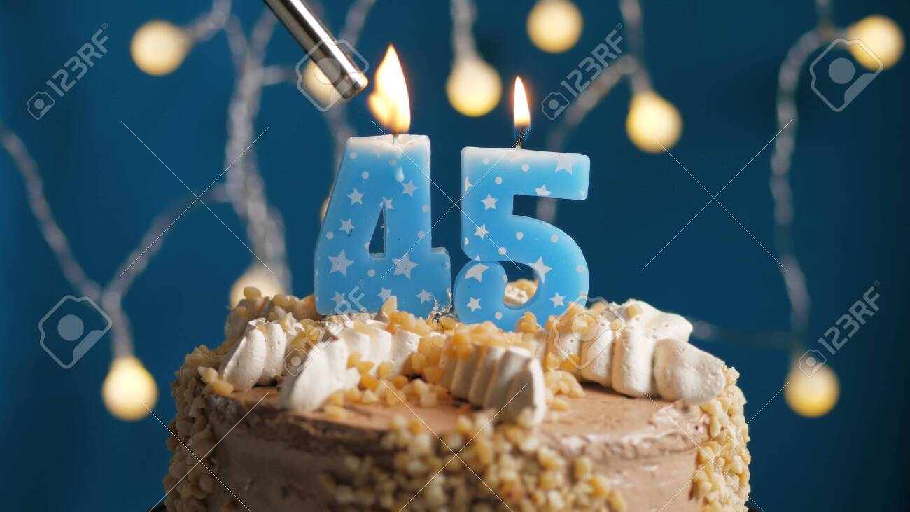 Remarkable Birthday Cake With 45 Number Candle On Blue Backgraund Set On Funny Birthday Cards Online Overcheapnameinfo