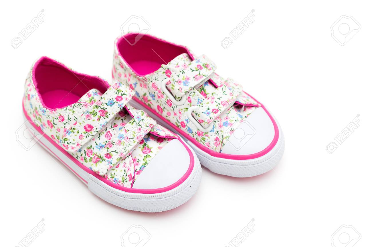 Girls Shoes In Flowers And Pink Color On A White Background