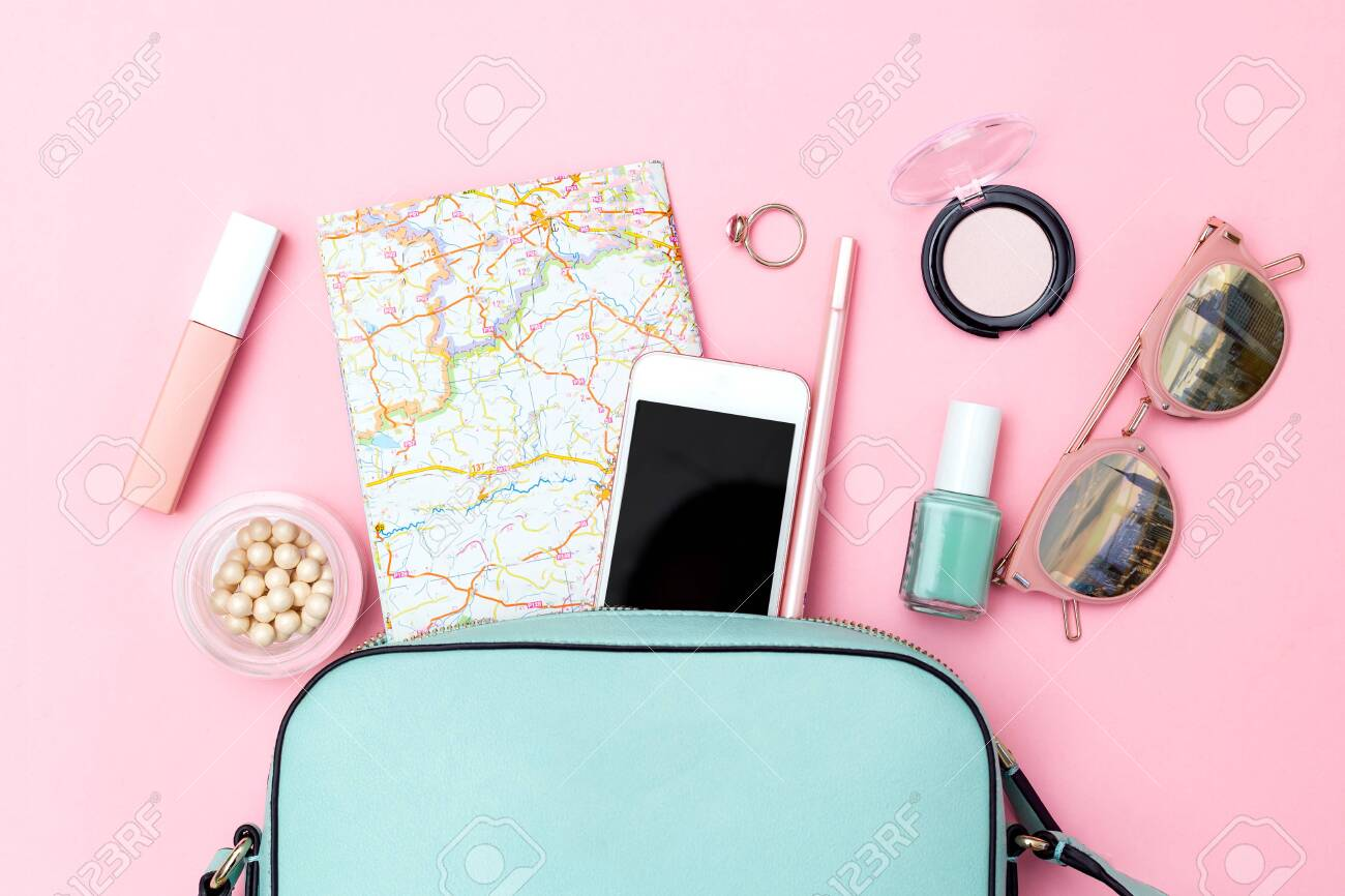 Accessories for travel on pink background. Flat lay - 122085702