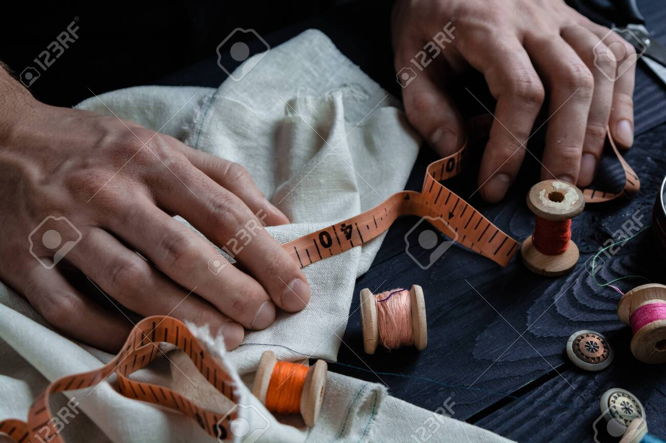 Male tailoring, sewing close up hands, craftsman - 120709798
