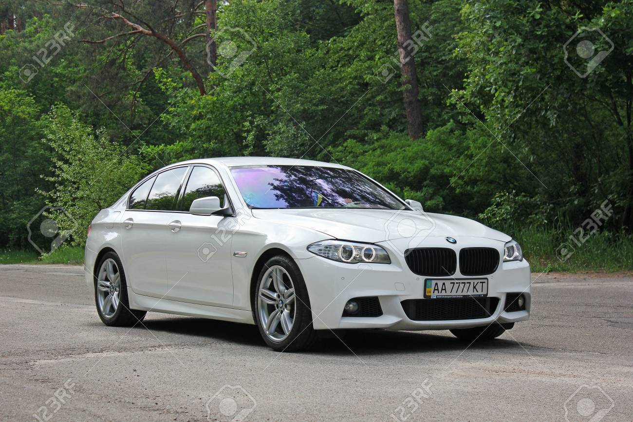 White Bmw 520 Tdi F10 M Sport In The Forest Road Kiev Ukraine Stock Photo Picture And Royalty Free Image Image 97175415
