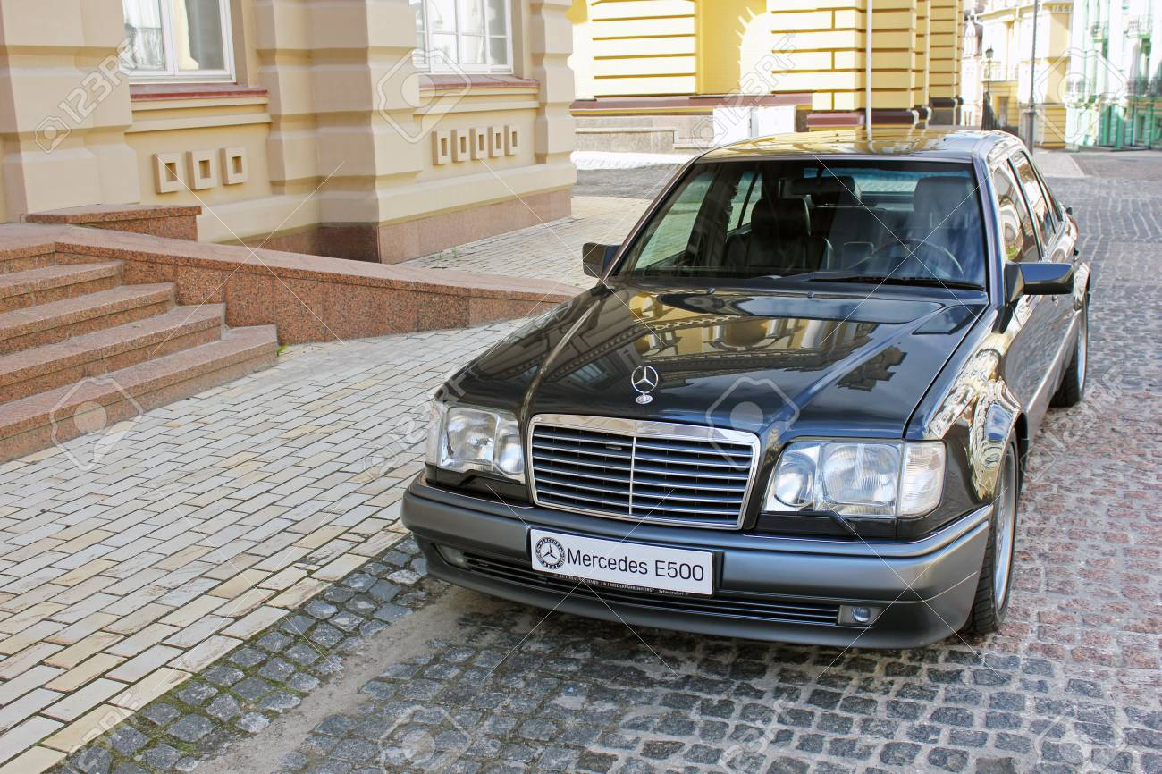 Mercedes E500 W124 Wolf on the background of beautiful old houses
