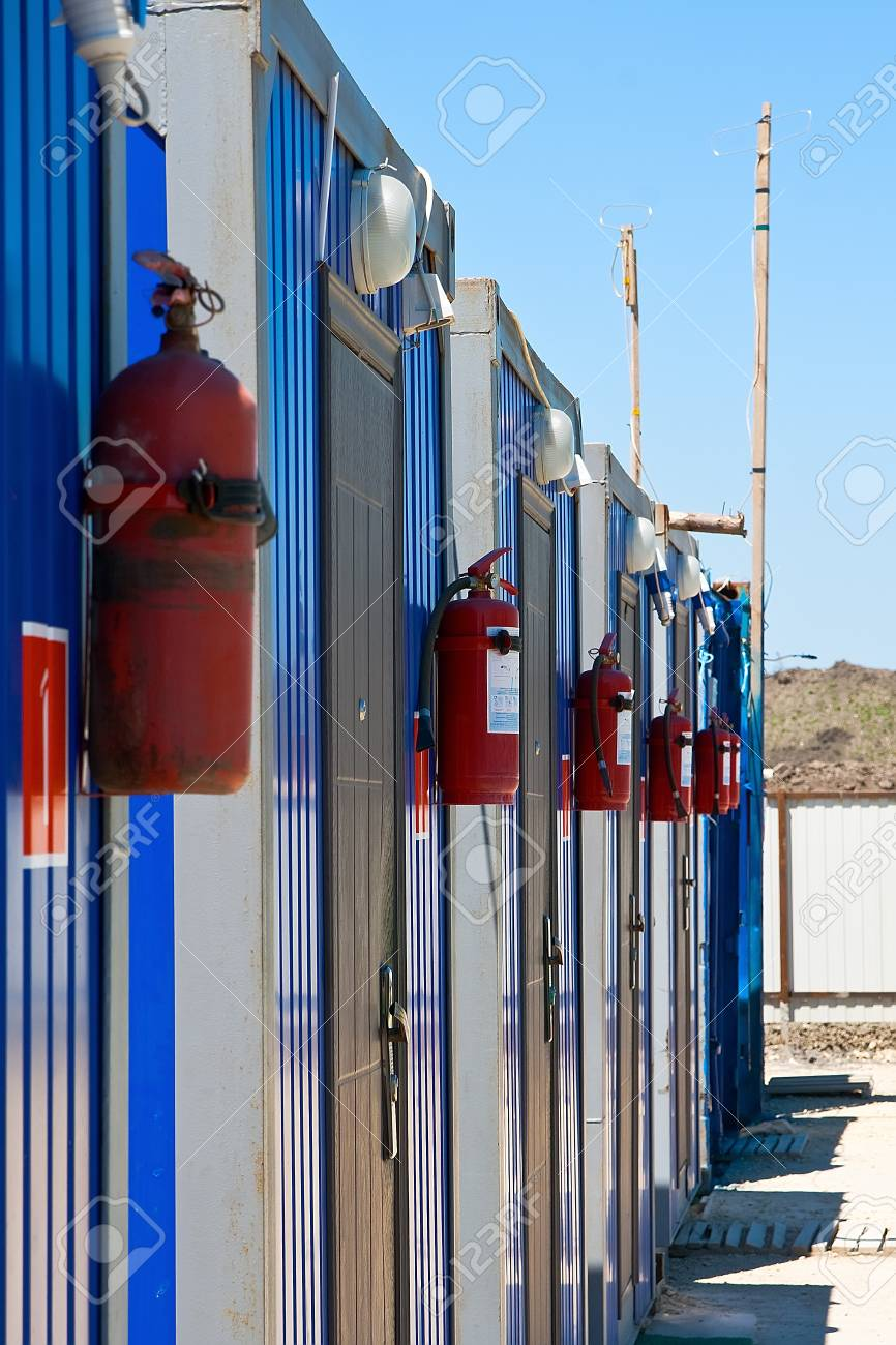 Fire prevention, fire extinguisher hanging on the workers Stock Photo - 14413249