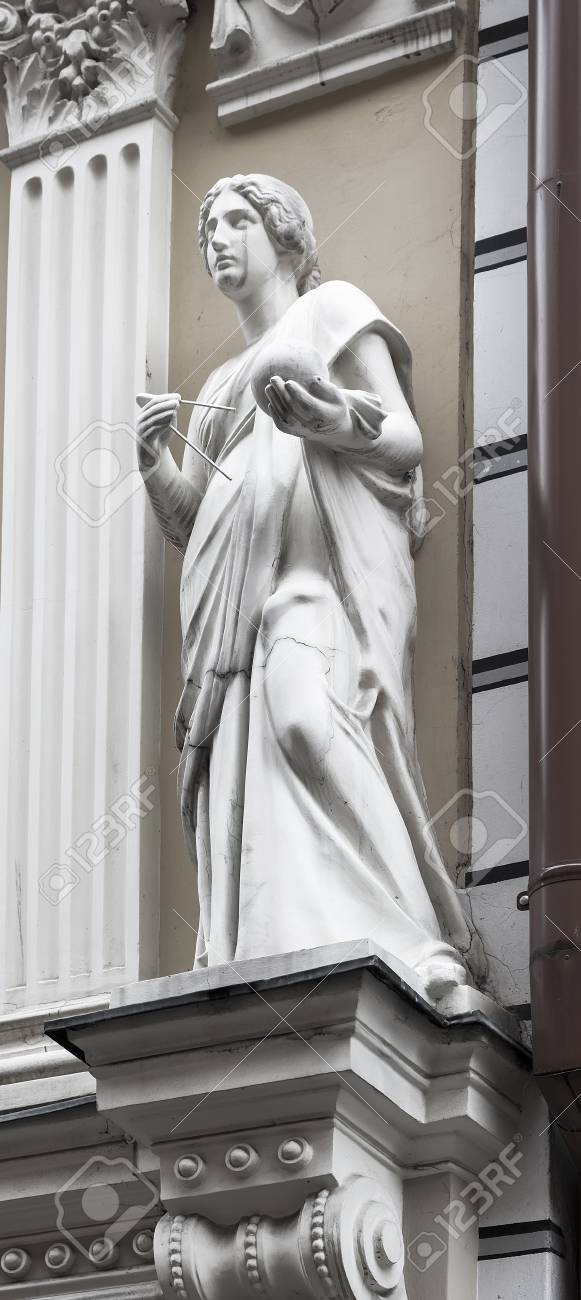 Woman sculpture on the facade of an old building Stock Photo - 24226810