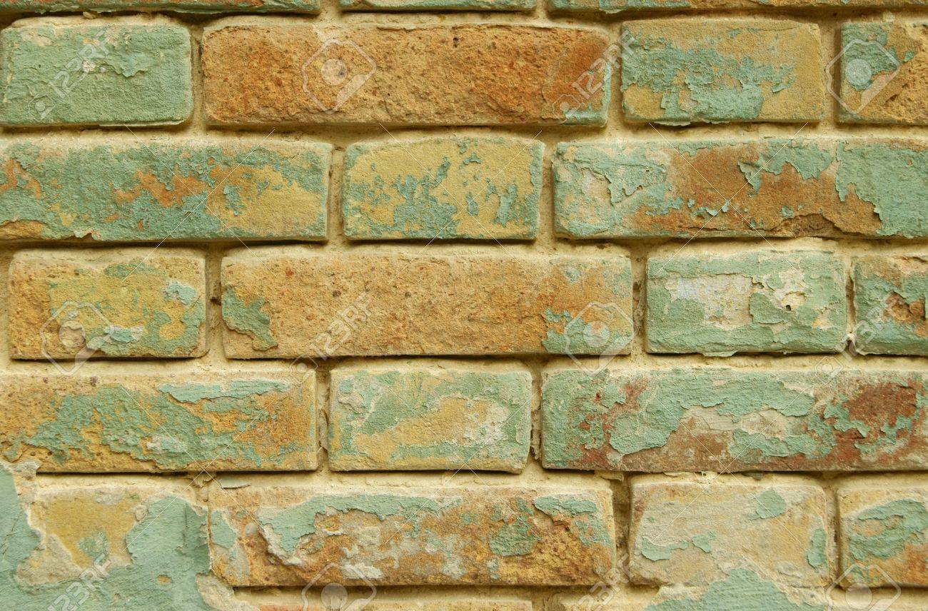 The Old Brick Wall, Painted In The Blue And Yellow Colors Stock ...
