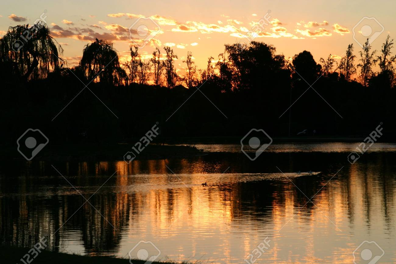 Black and Orange sunset at a lake Stock Photo - 2638984