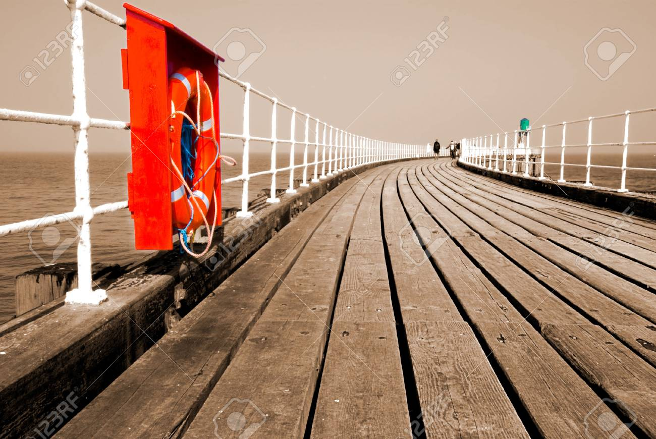 Whitby pier in sepia with red lifebelt Stock Photo - 3284533