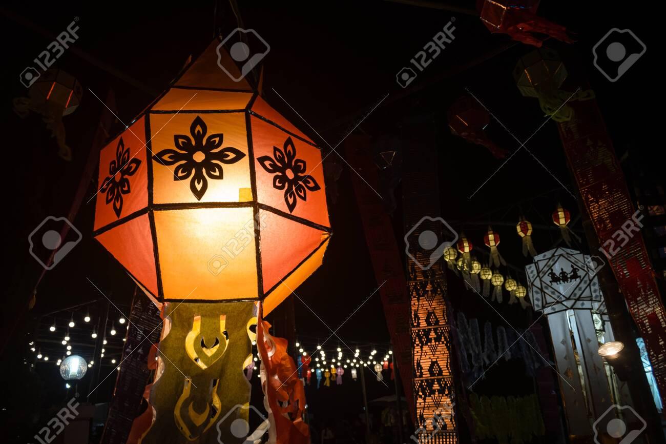 Orange Paper lanterns in Loi Krathong festival on Left Frame. Lanterns contest in Loi Krathong festival at Phayao Thailand - 135987496