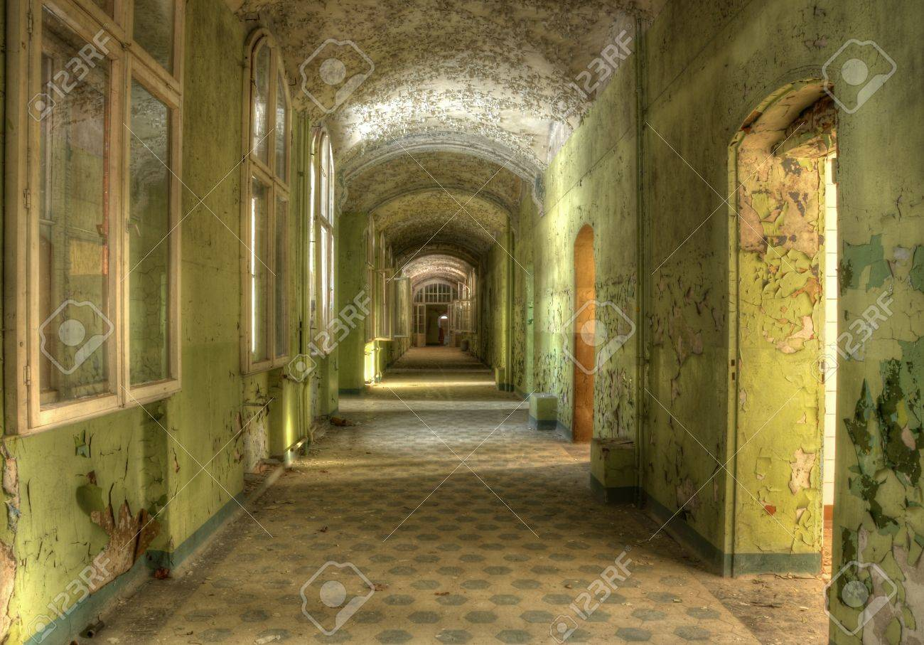 Long corridor with green wall color stock photo picture and