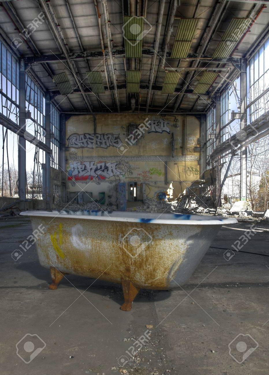 Old Abandoned Bathtub In A Warehouse Stock Photo, Picture And ...