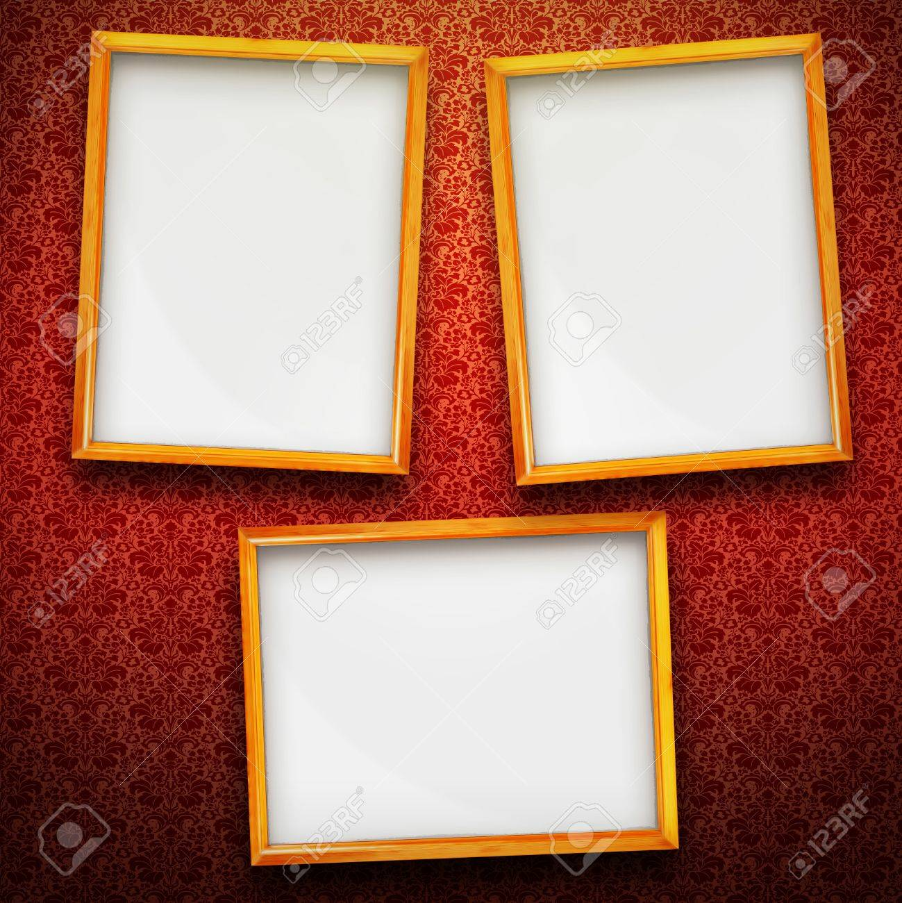 stock photo three big picture frames in gold on red vintage background