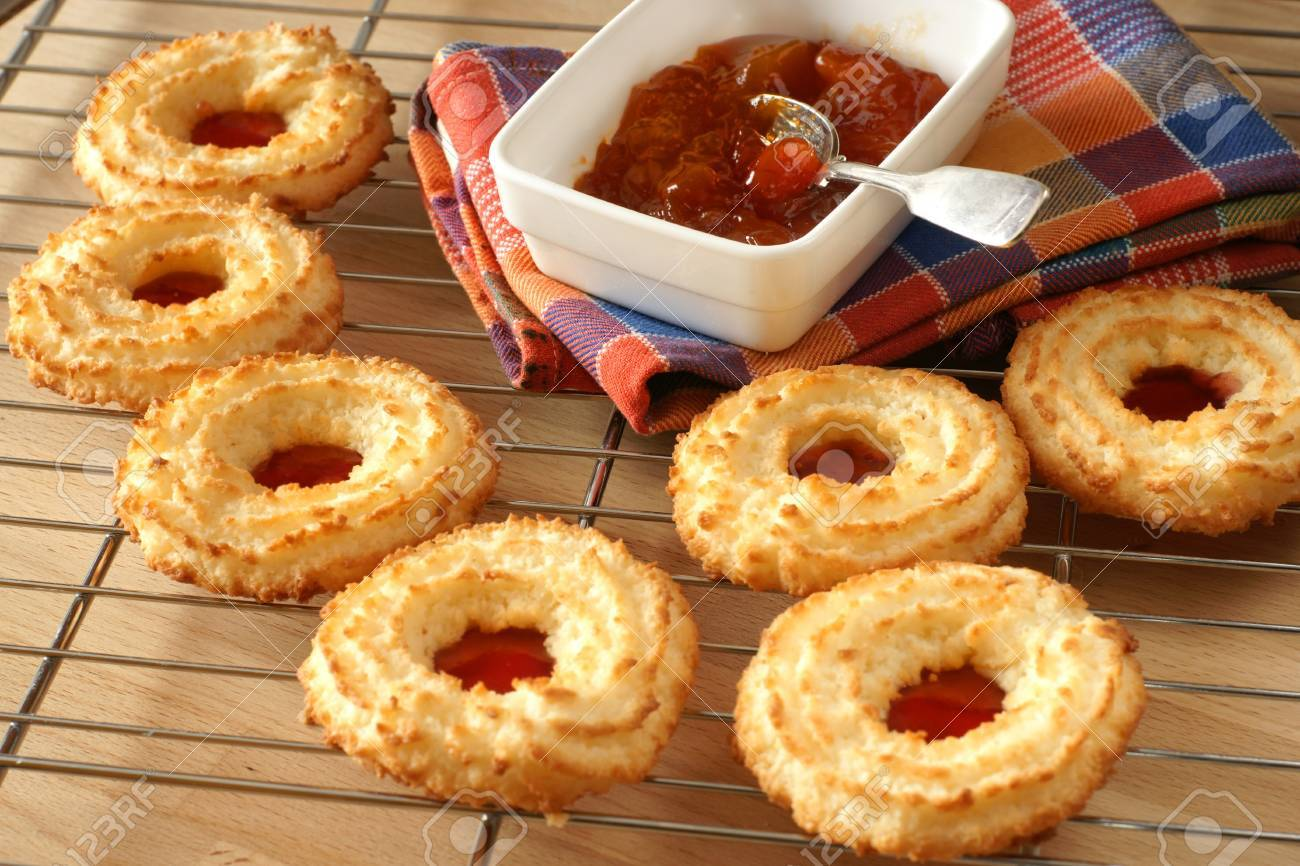 Freshly baked homemade coconut biscuits filled with jam Stock Photo - 4415202