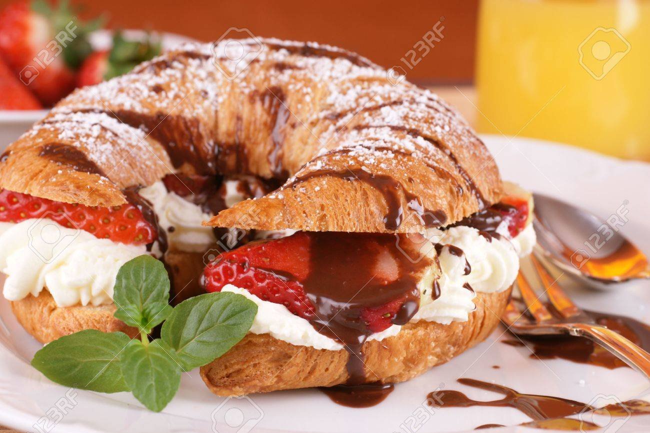 French croissant with cream and strawberries Stock Photo - 4459427