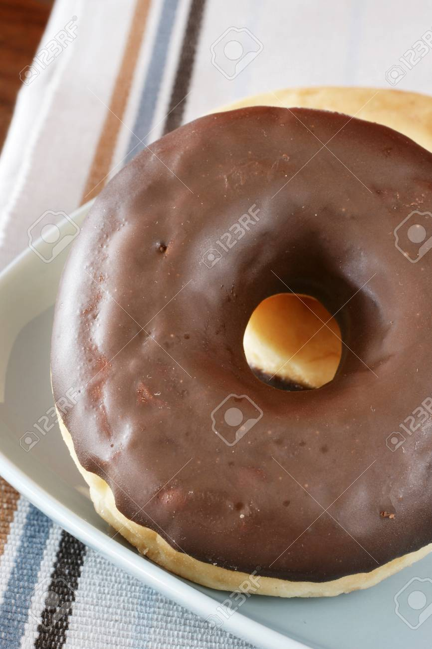Two chocolate donuts served on blue a dish Stock Photo - 11836831