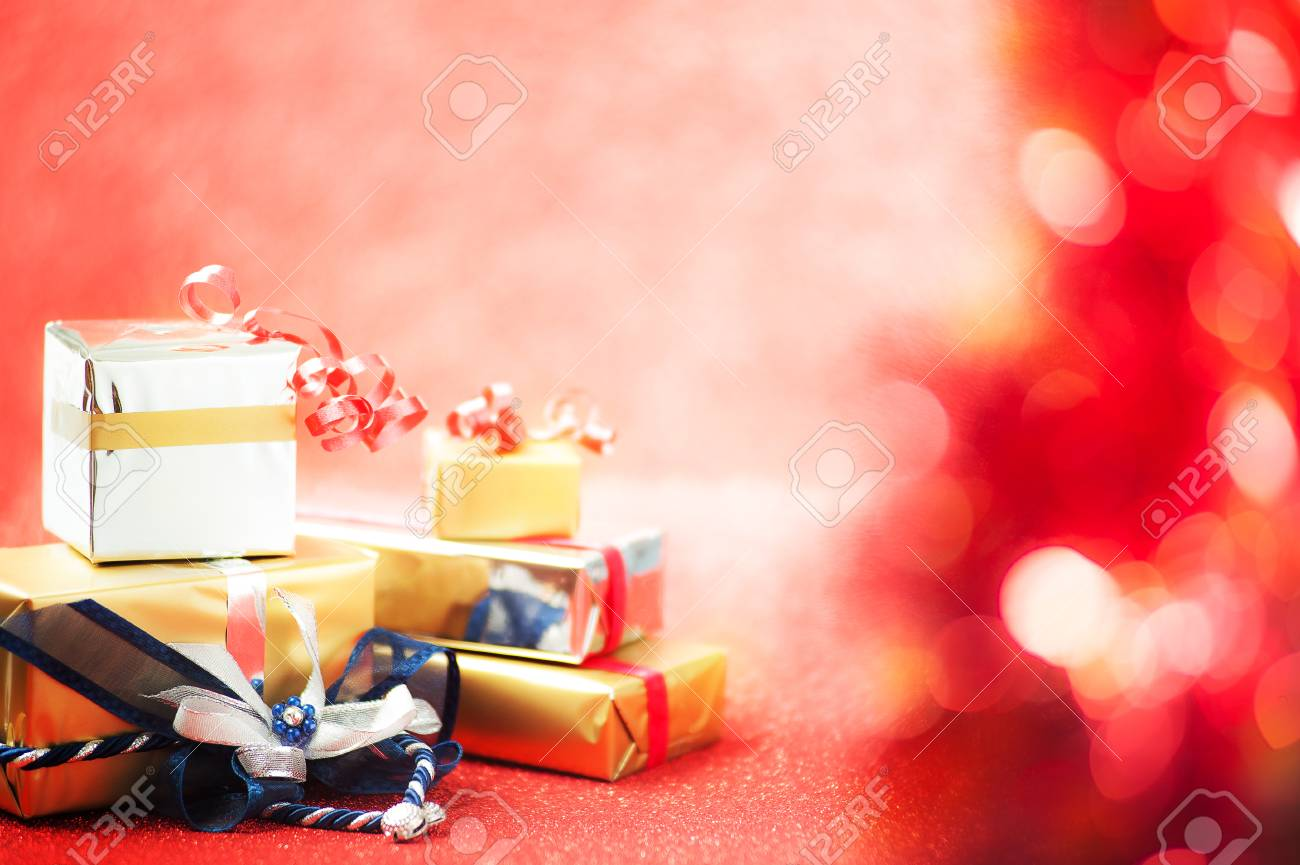 Christmas Gifts On Shimmery And Blurry Red Background Stock Photo ...