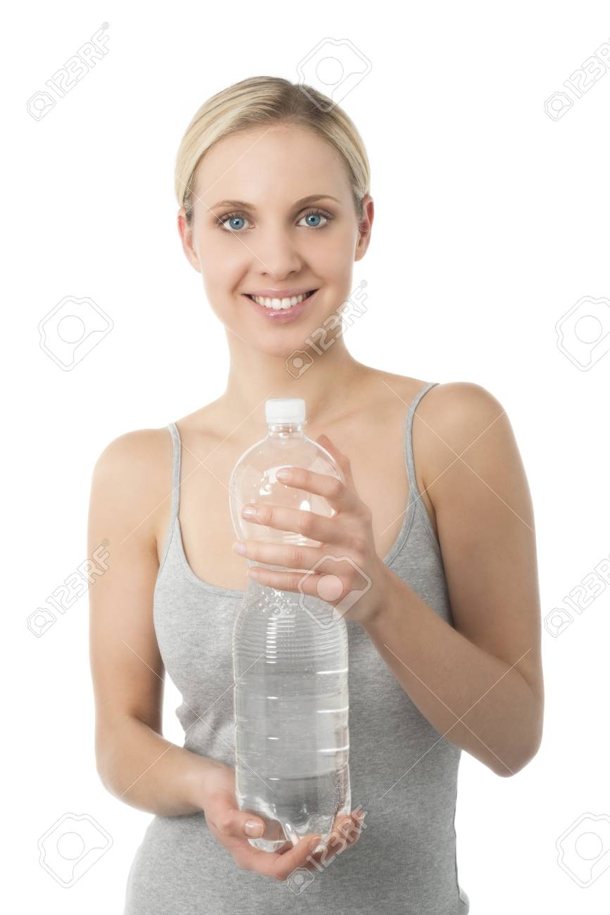 Young woman holding bottle of water Stock Photo - 7368784