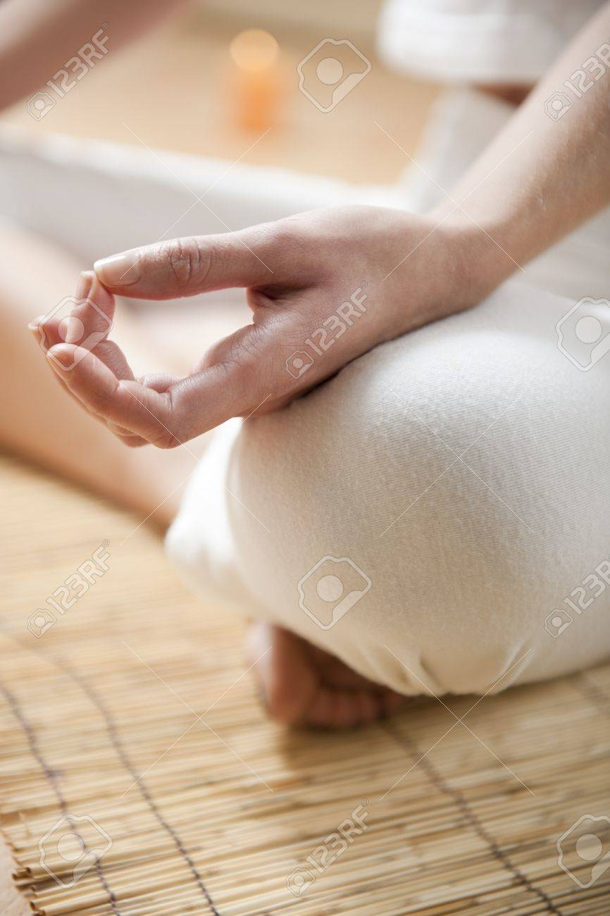 Hands of young woman meditating, focus on the hand Stock Photo - 7368980