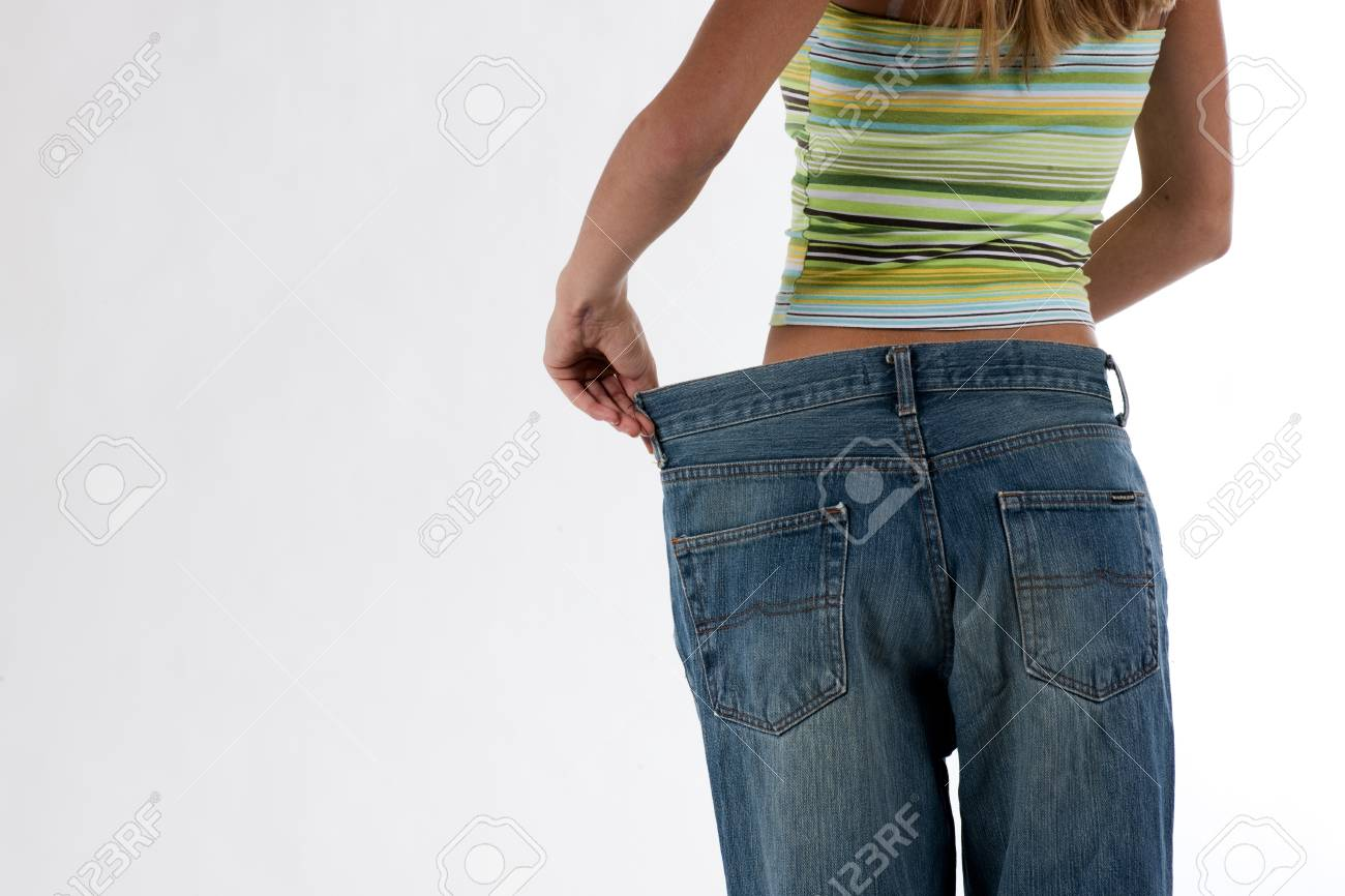 Young woman became skinny and wearing old jeans Stock Photo - 7388298