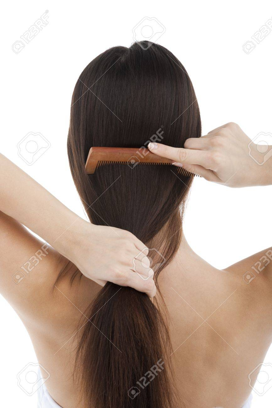 Rear view of a woman combing her hair Stock Photo - 7417568