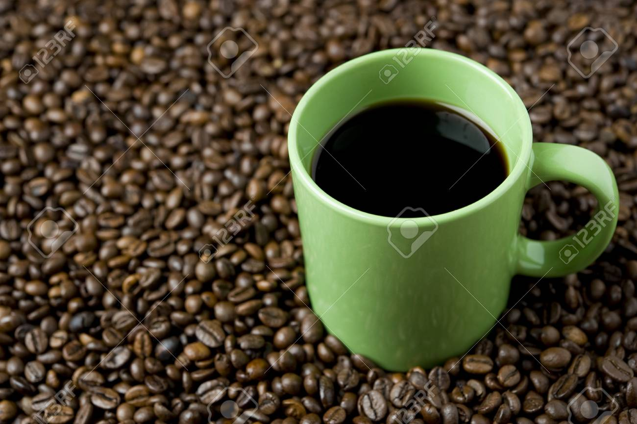 Coffee cup on coffee beans Stock Photo - 7417622